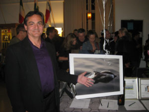 Michael displays his work at a gallery opening in San Diego.